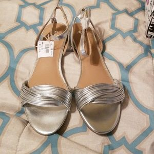 Cute silver shoes size 8, new with tags.